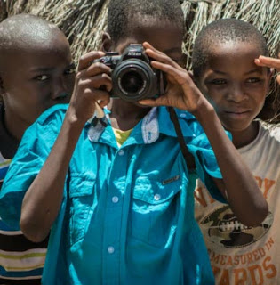 Taking pictures with friends in Mozambique Africa.