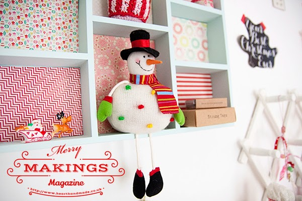 Decorative shelves on a craft room wall - using christmas cake toppers to decorate for christmas