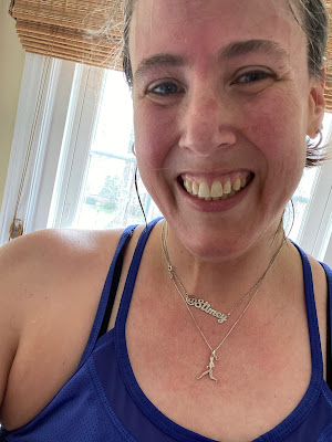 "Selfie of me post workout wearing the runner necklace and a necklace that reads ""Stimey"""
