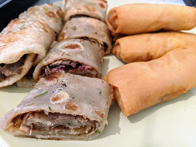 Pan-Fried Cake with Marinated Beef and Spring Rolls
