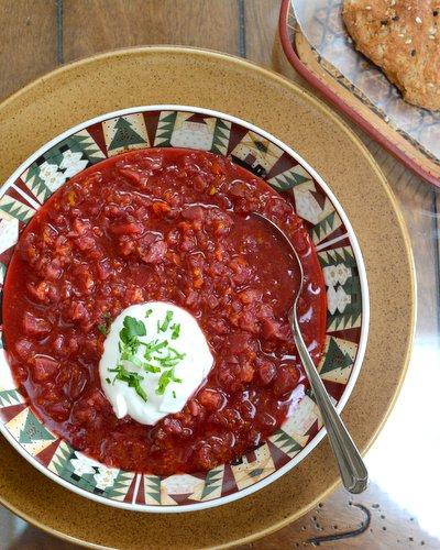 Karelian Borscht (Russian Beet Borscht Soup) ♥ KitchenParade.com, extra hearty with sausage and a swirl of sour cream but also especially earthy and delicious as a vegetarian borscht.