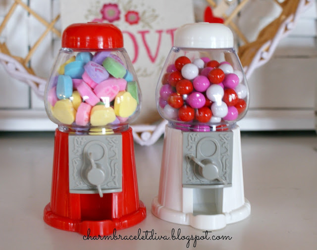 Mini gumball machines filled with conversation hearts and candy coated chocolate