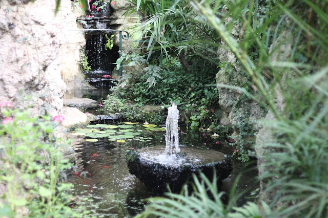 waterfall and fountain at dewstow gardens wales