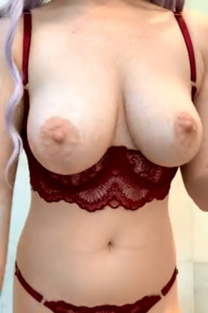 naked boobs out of bra of busty lady