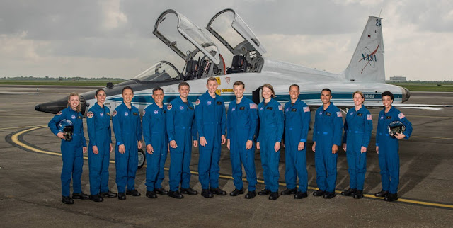 "NASA announced its 2017 Astronaut Candidate Class on June 7, 2017. The 12 candidates, pictured here at NASA's Ellington Field in Houston, are Zena Cardman, U.S. Marine Corps Maj. Jasmin Moghbeli, U.S. Navy Lt. Jonny Kim, U.S. Army Maj. Francisco ""Frank"" Rubio, U.S. Navy Lt. Cmdr. Matthew Dominick, Warren ""Woody"" Hoburg, Robb Kulin, U.S. Navy Lt. Kayla Barron, Bob Hines, U.S. Air Force Lt. Col. Raja Chari, Loral O'Hara and Jessica Watkins. Credits: NASA/Robert Markowitz"