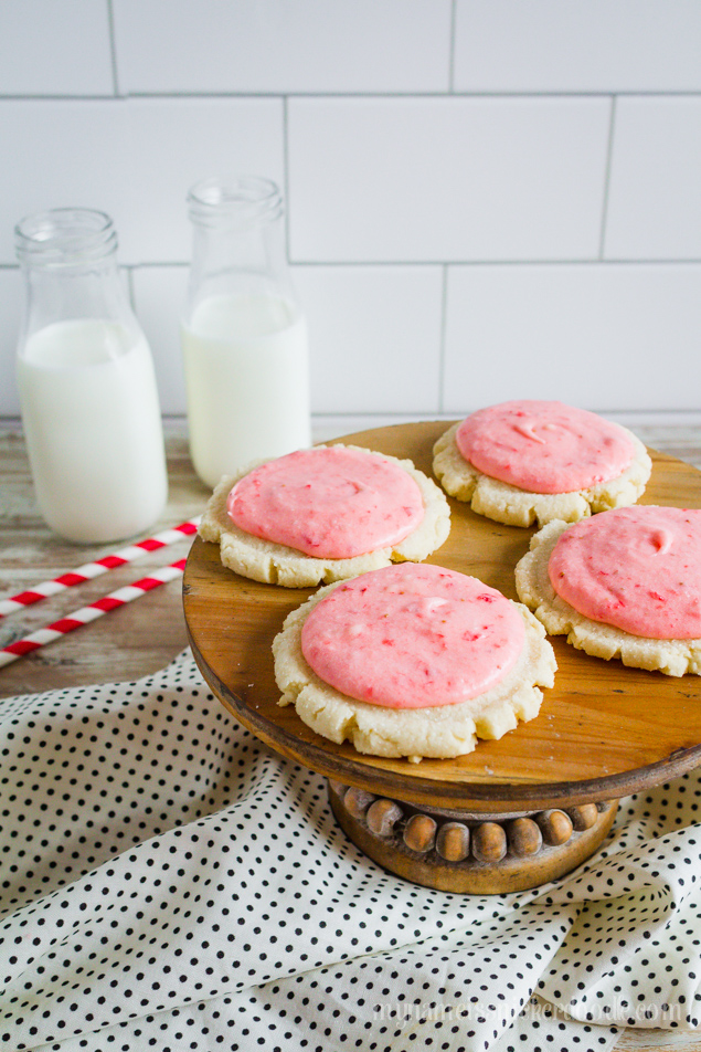 Strawberries and Cream Sugar Cookies!  An updated sugar cookie recipe frosted with a fresh strawberry butter cream frosting!  |  mynameissnickerdoodle.com
