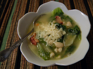 Bowl of Escarole Bean Soup with Grated Parmesan