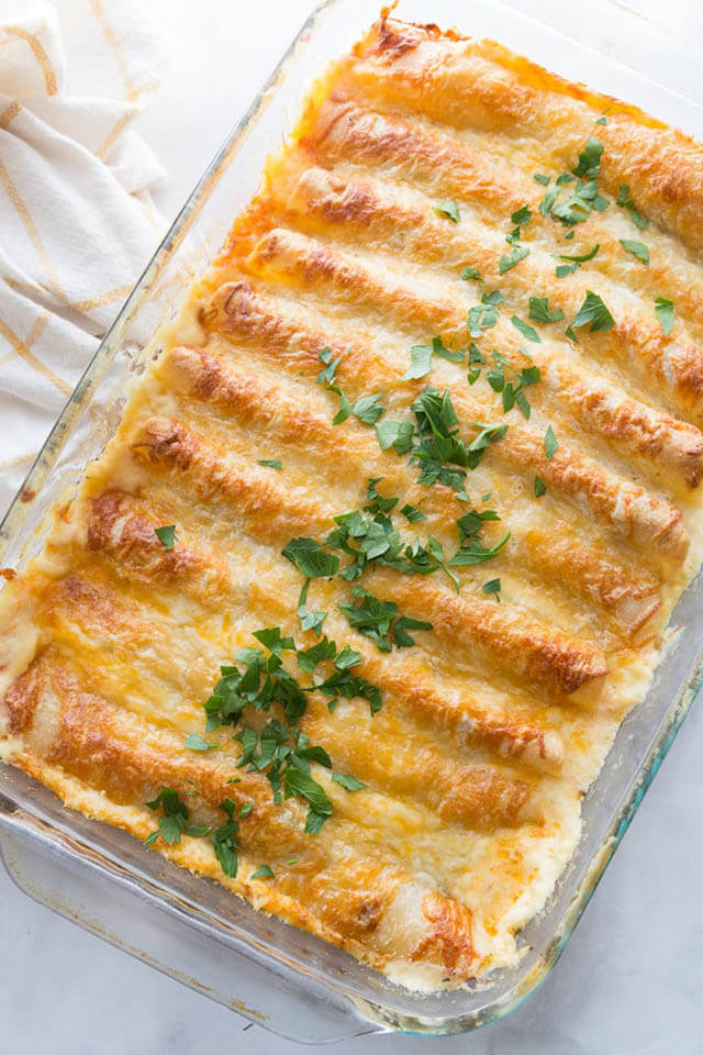 Creamy White Chicken Enchiladas by Play Party Plan (Easy Recipe For Using Leftover Cooked Chicken)