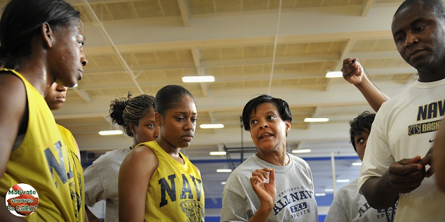 "Featured in the article: ""How To Motivate Youth Basketball Players"". Don't Let Your Emotions Take Over, coach talking to youth basketball player in a proper controlled manner."