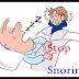 What are the causes of snoring while sleeping?