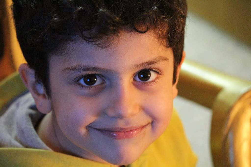 NAMC Montessori circle of inclusion: personalized instruction scientific observation and individual readiness. Headshot of young boy smiling.