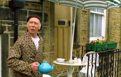 Old bloke with tea pot and breakfast table