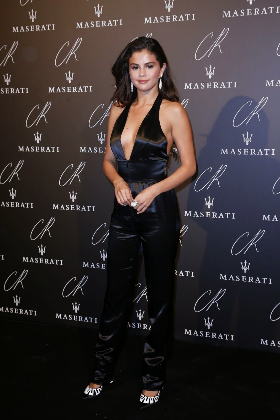 ecbdc24a9b2 Selena Gomez wears a bold low-cut jumpsuit to the CR Fashion Book  5 Paris  Launch Party