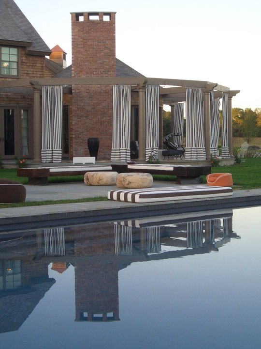 Photo of terrace and the pool furniture by the pool