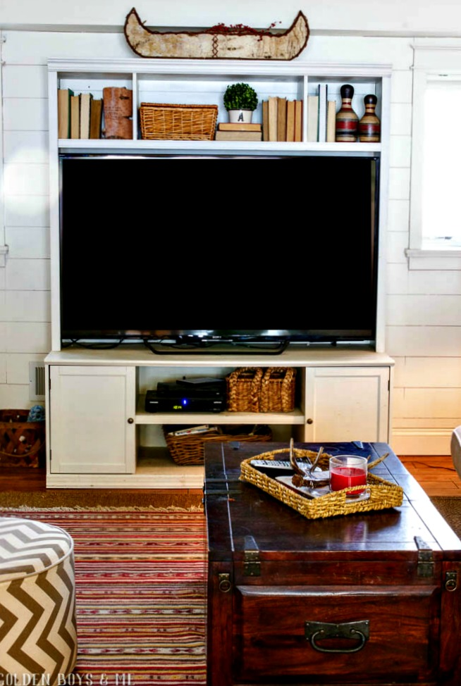 Pottery Barn tv stand on planked wall