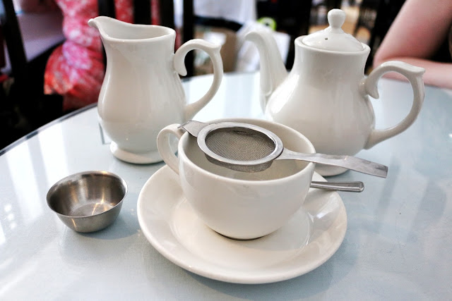 Close up of white cup and white tea pot from Willow tea rooms