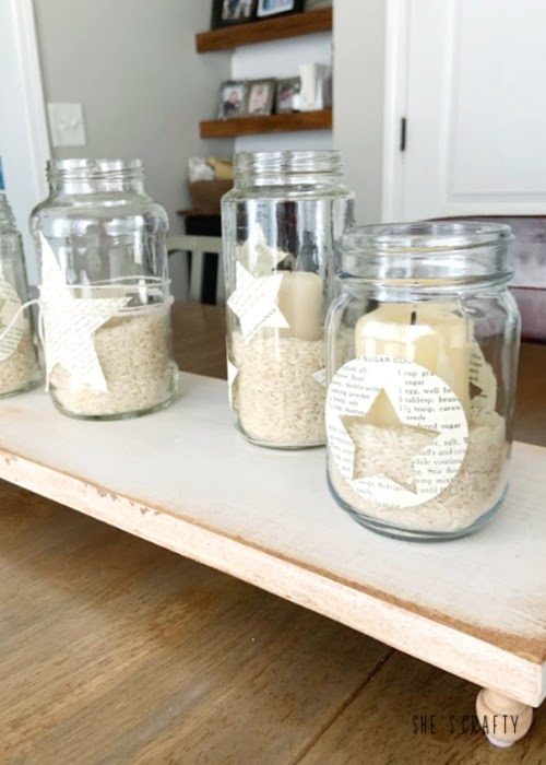 Add rice and candles to book page decorated star jars for table centerpiece