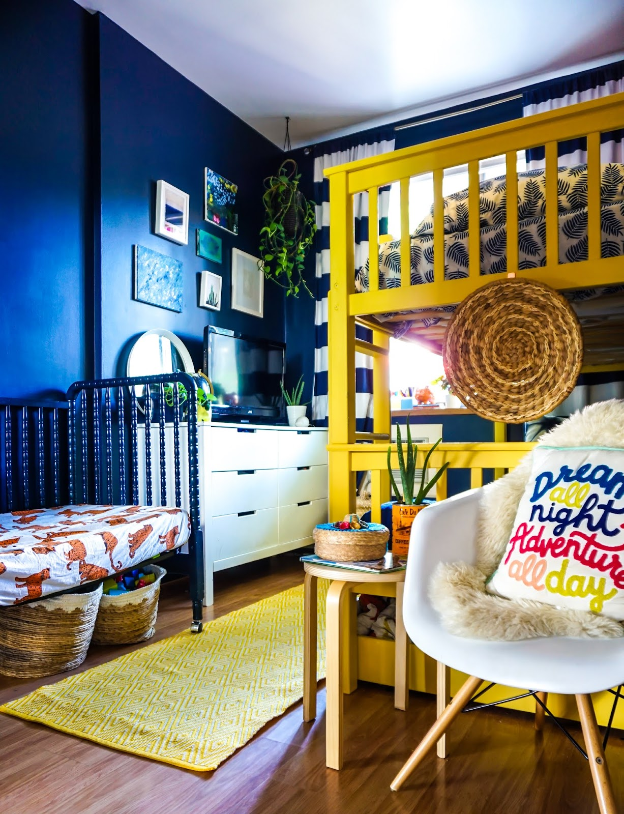 colorful kids bedroom ideas // colorful kids room // colorful boys room // colorful bohemian kids bedroom // Clare paint golden hour // clare paint goodnight moon // best paint for kids bedroom // non-voc paint clare // boho kids room // tropical inspired kids bedroom // tropical inspired boys room // Hawaii inspired boys room // bohemian kids room decor // colorful kids room inspo // yellow bunk bed // navy blue walls bedroom // boho kids bedroom //  colorful boho kids room inspo // navy striped curtains // colorful bunk beds // tropical kids bedroom ideas // Hawaii inspired kids bedroom