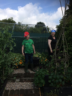 Mother and son gardening