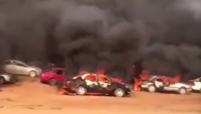 #EndSARS: Policemen Watch As Thugs Burn Over 200 Cars Belonging To Protesters In Abuja