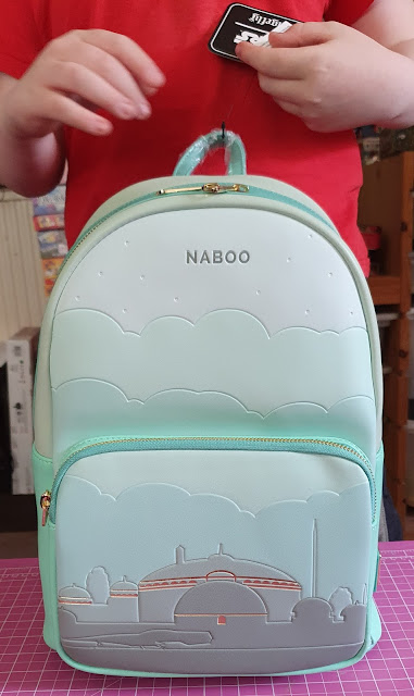 Naboo Loungefly backpack being examined by young Star Wars fan