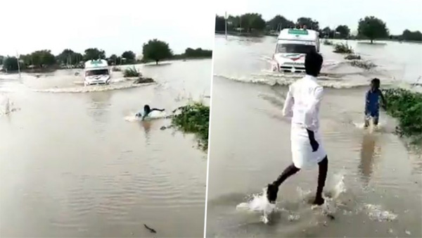 Karnataka, News, National, Video, Boy, River, Rain, Boy Risking His Life to Guide an Ambulance Through Flooded Bridge Over Krishna River on Devadurga
