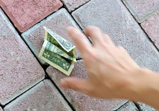 picking money of floor