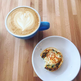 A honey latte and mini spinach quiche at Magpie Cafe Downtown