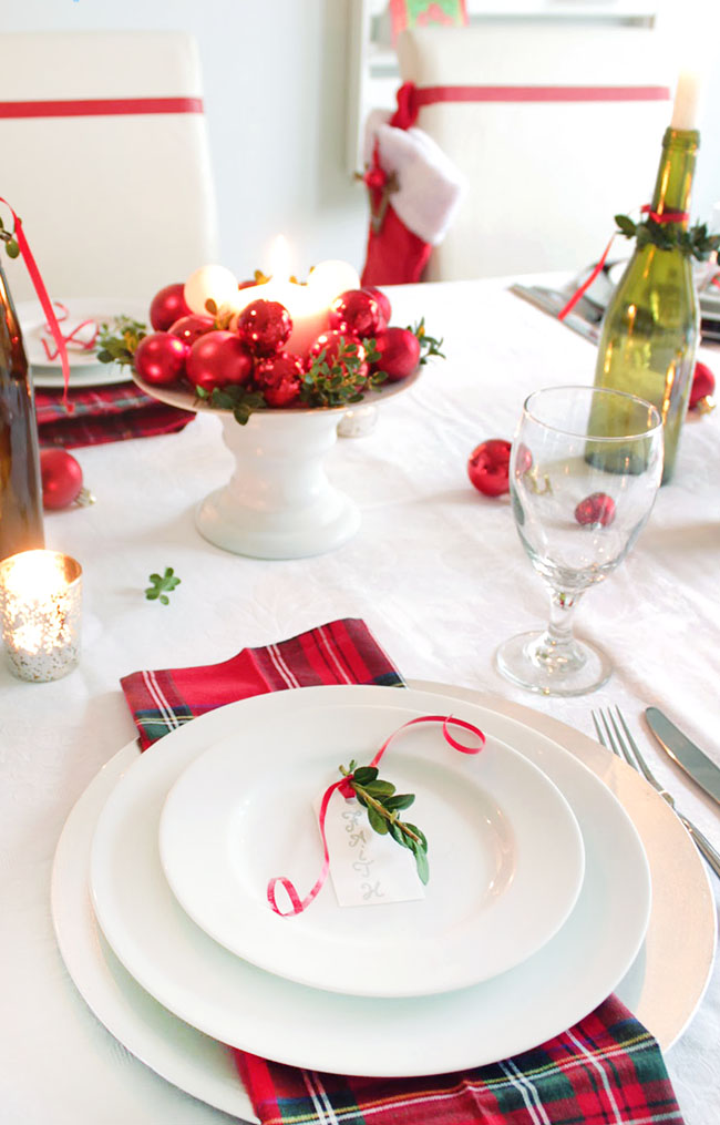 Christmas decor in the dining room with red napkins green bottles