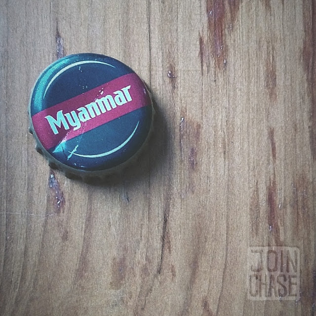 A bottle cap from a Myanmar beer rests on a table in Yangon.