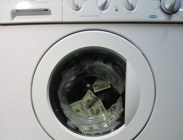 Image: Money Laundering, by Karen Barefoot on freeimages