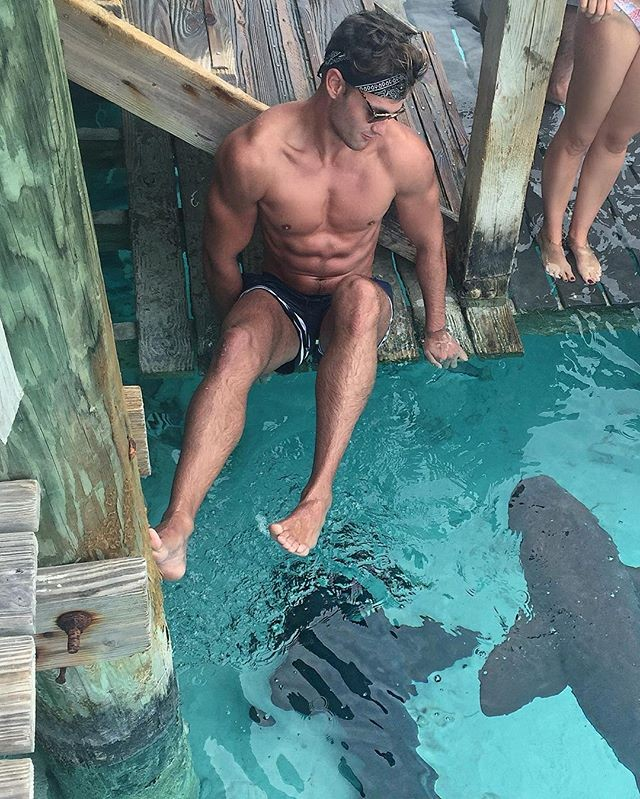 brave-boy-swimming-with-sharks