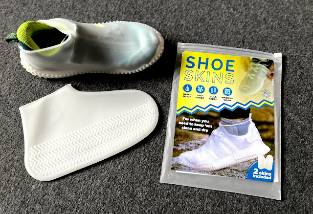 a transparent silicone shoe cover on a trainer, one next to the trainer and the shoe skin packaging
