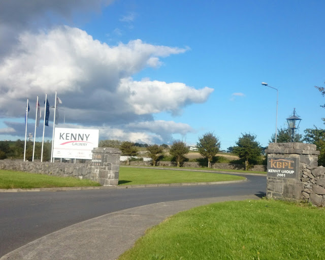 wide industrial estate driveway, entrance to the Kenny Group Tuam Rd premises.
