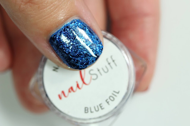 Blue Metallic Nail Flakes from NailStuff shown over blue nail polish on one nail