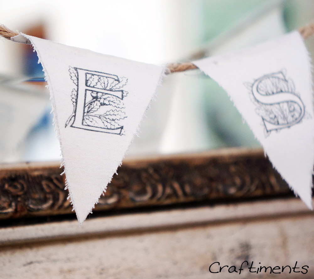 Craftiments:  Closeup of miniature fabric and twine bunting