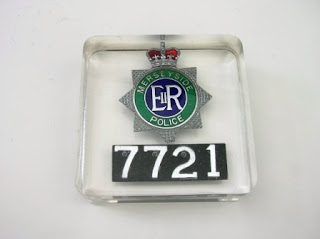 Paperweight containing a Police badge