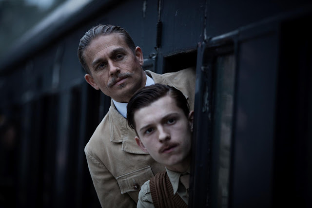 Charlie Hunnam as Col. Percival Fawcett and Tom Holland as Jack Fawcett in The Lost City of Z