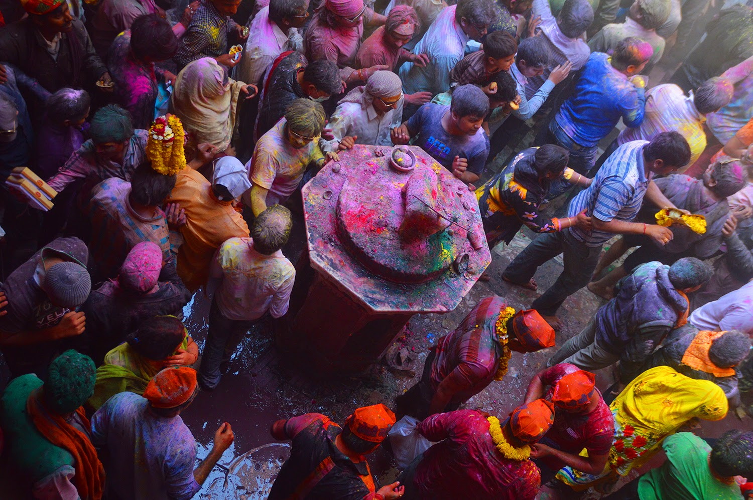 Crowd of Indian men Holi Banke Bihari Temple Vrindavan 2015 colors gulal red yellow green men