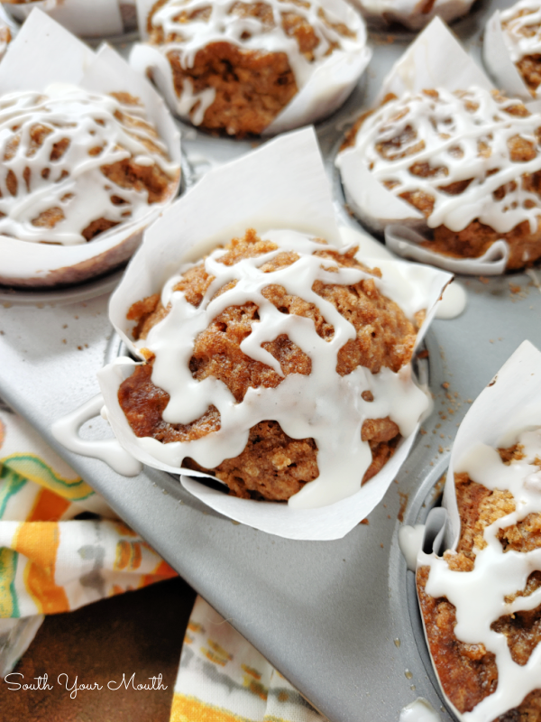 Banana Muffins with Cinnamon Streusel Topping! Moist, tender banana bread muffins finished with an easy cinnamon praline crumb topping drizzled with simple vanilla cream icing.