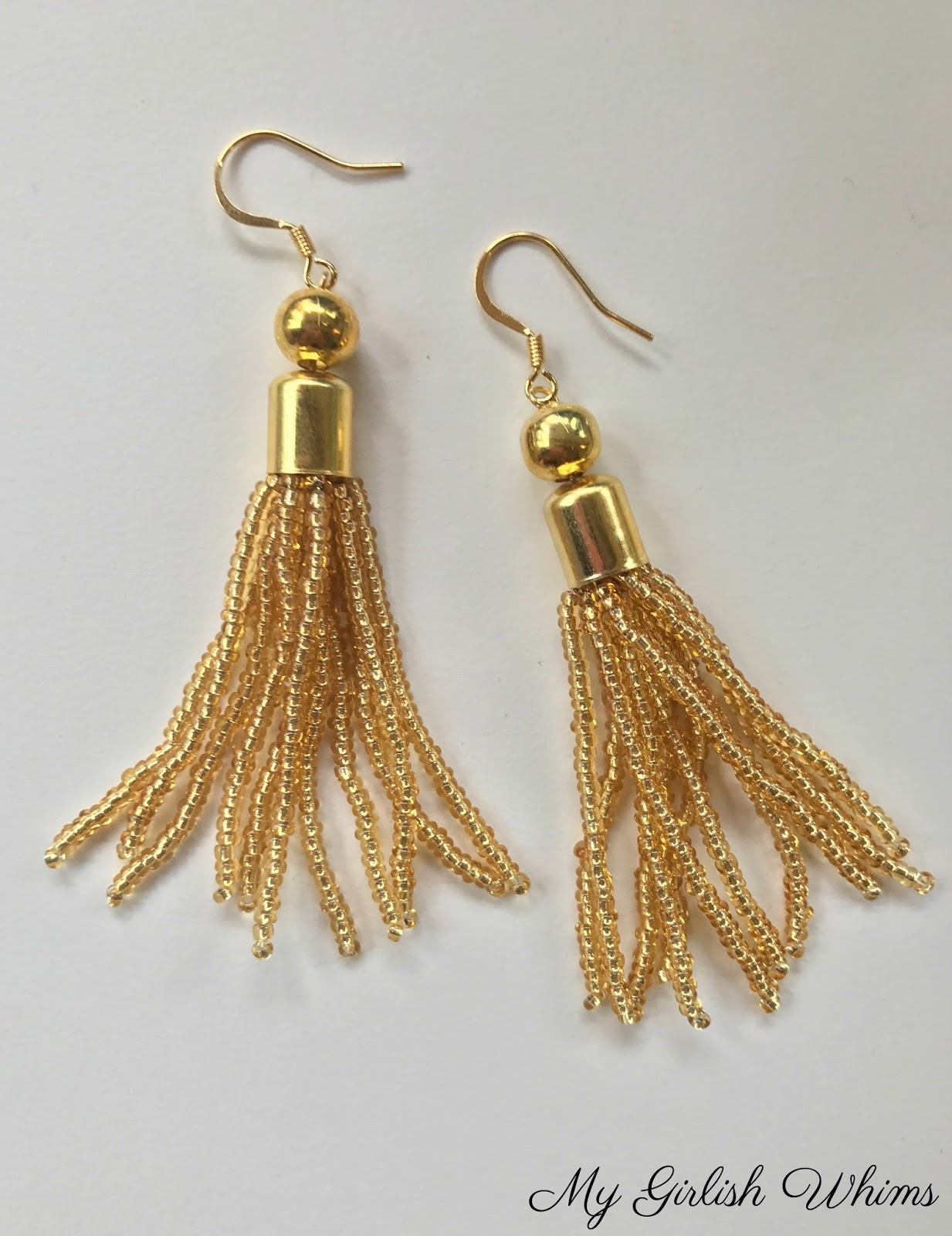 tan emilymccarthy raffia tassle com tassel earrings products