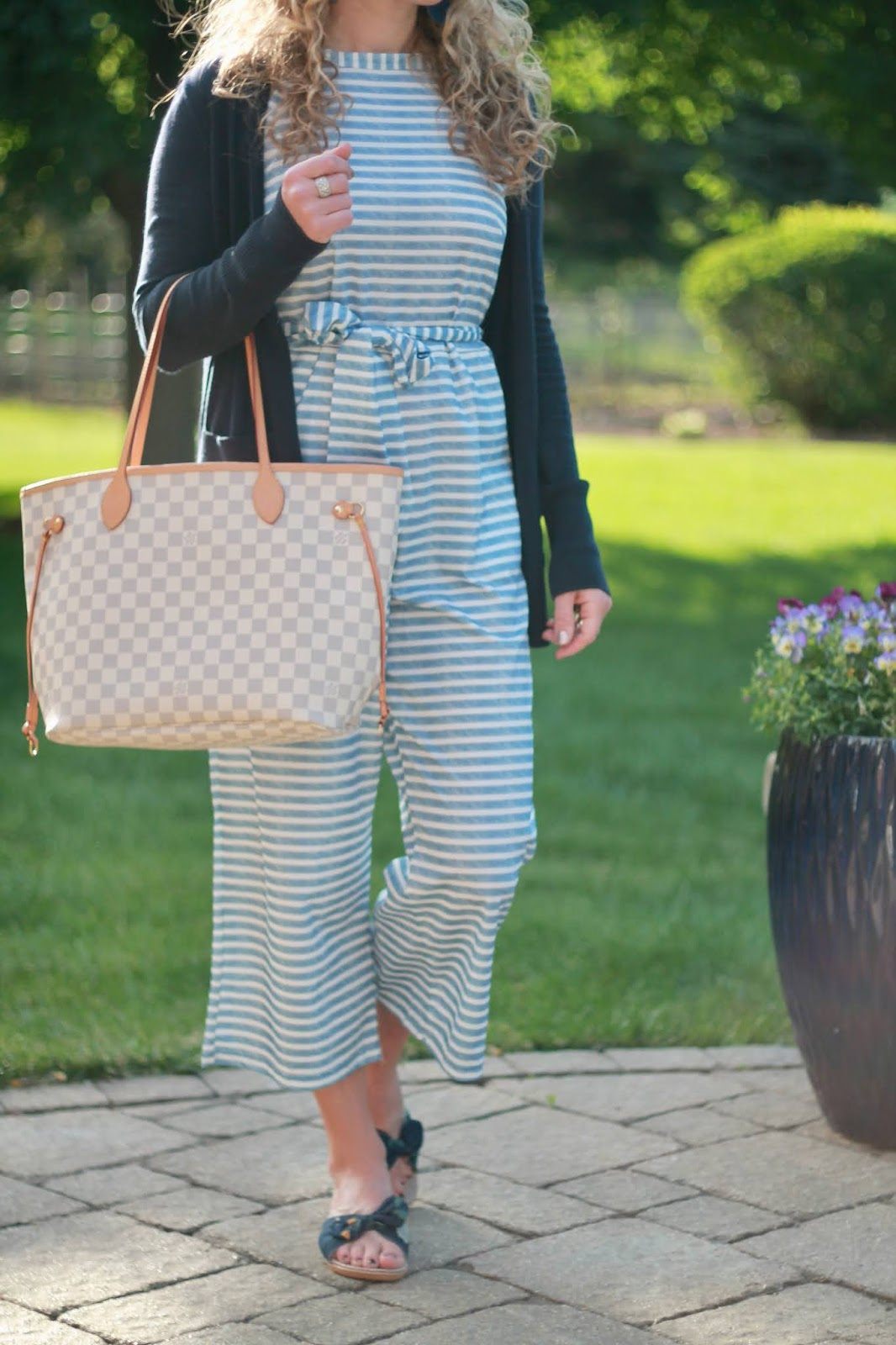 blue striped jumpsuit, navy boyfriend cardigan, casual jumpsuit outfit, navy slide sandals, LV azure neverfull