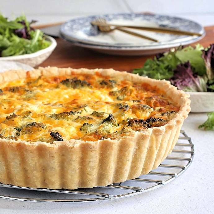 Recipe for a deep dish quiche with a savory crust and broccoli and cheddar cheese filling.