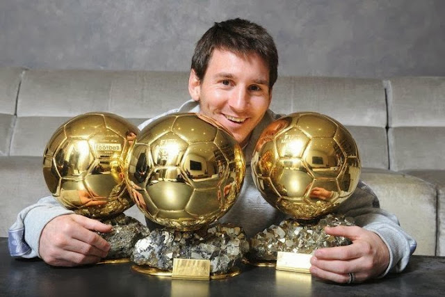 Lionel Messi with his thre FIFA Ballon d'Or Awards