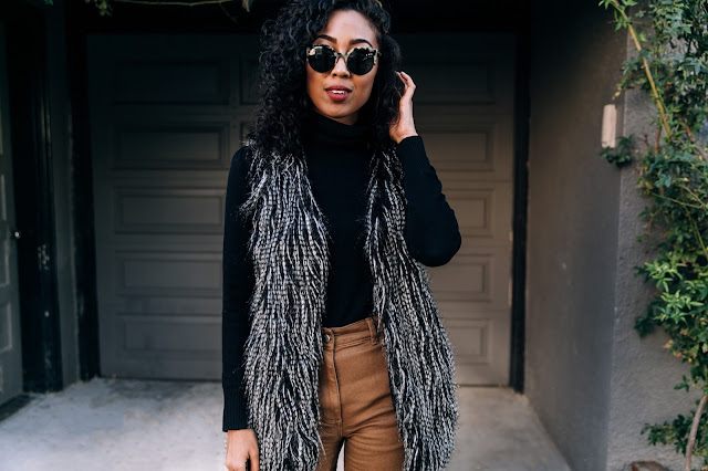 pancake stacker wearing a fuzzy faux fur vest, everlane wide leg crop pants, everlane day heels, and a gap turtlneck sweater