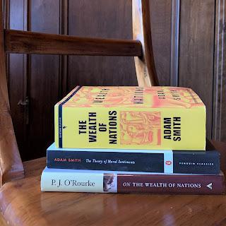 stack of Adam Smith books