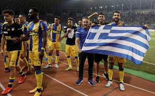"""«""""Σταύρωσαν"""" τον Μερκή επειδή πανηγύρισε με την Ελληνική σημαία» γράφει ο Μιχάλης Ιγνατίου"""