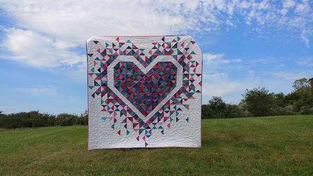 Heart quilt with quarter square triangles