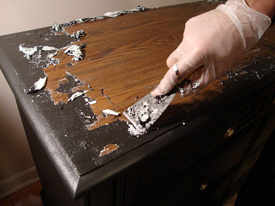 applying paint stripper