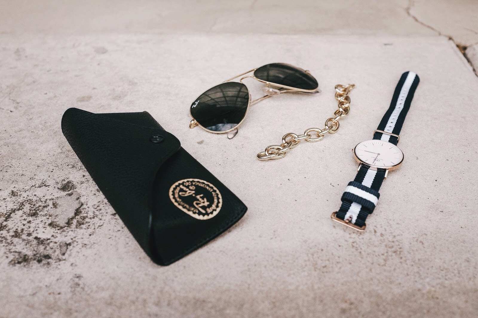 gold ray ban aviators gold link bracelet and strip rose gold daniel wellington watch